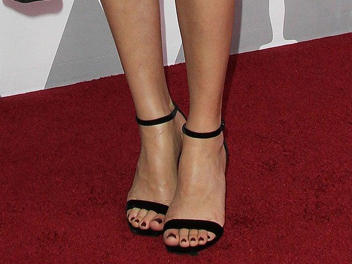 Margot Robbie's Saint Laurent 'Amber' velvet ankle-strap sandals up close.