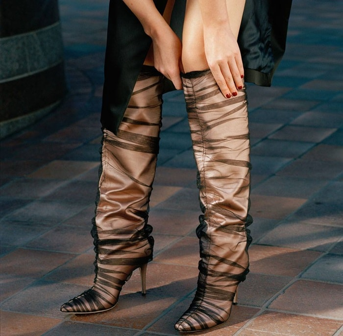 These 'Elisabeth' knee boots are made from blush satin and covered with ruched black tulle