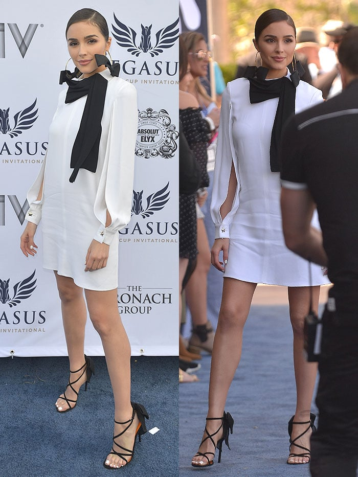 Olivia Culpo accessorized with grosgrain-bow-adorned gold hoop earrings and Walter De Silva bow-embellished strappy sandals