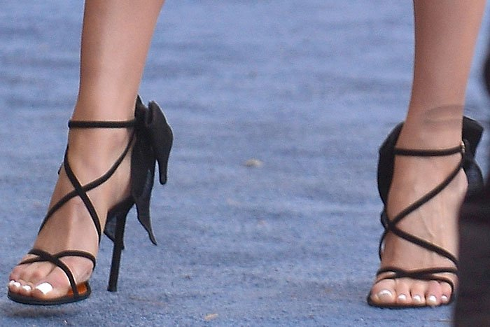 Olivia Culpo's feet in Walter De Silva bow-embellished strappy sandals