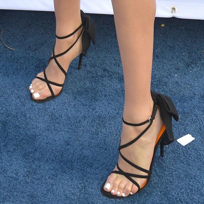 Olivia Culpo'sbow-embellished stilettos
