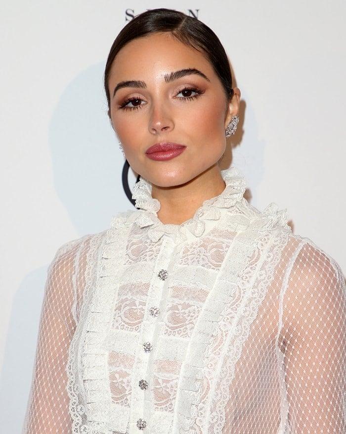 Olivia Culpo wearing diamond cluster earrings from Hueb