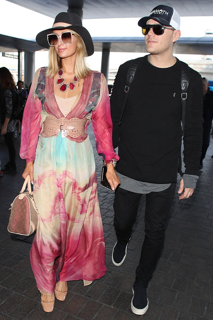 Paris Hilton and fiancé Chris Zylka departing fromLos Angeles International Airport (LAX) in Los Angeles, California, on January 24, 2018.
