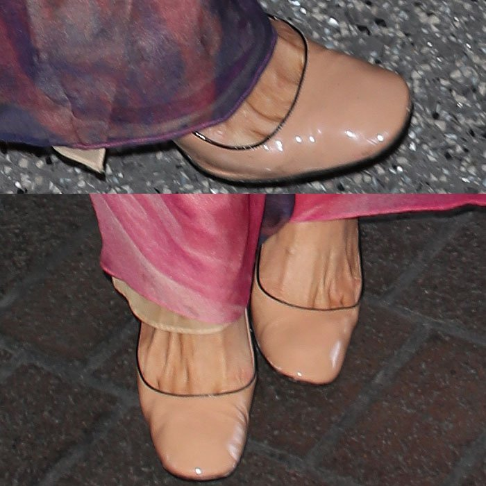 Closeups of the nude, square-toe flats with black piping on Paris Hilton.