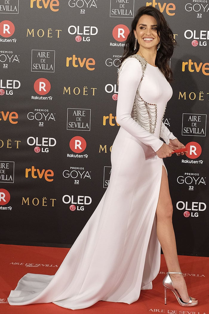 Penelope Cruz was white hot in a pristine Atelier Versacelong-sleeved gown with a short train