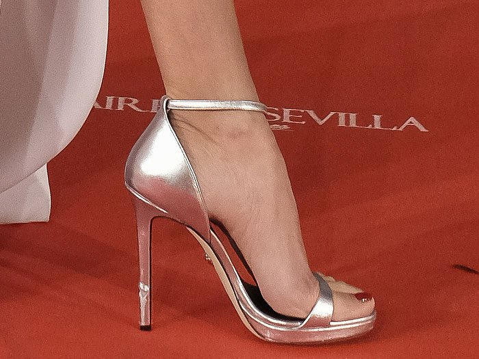 Closeups of the silver Versace ankle-strap sandals on Penelope Cruz.