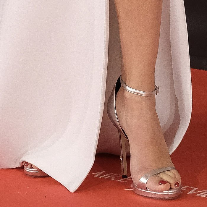 Silver Versace ankle-strap sandals on Penelope Cruz.