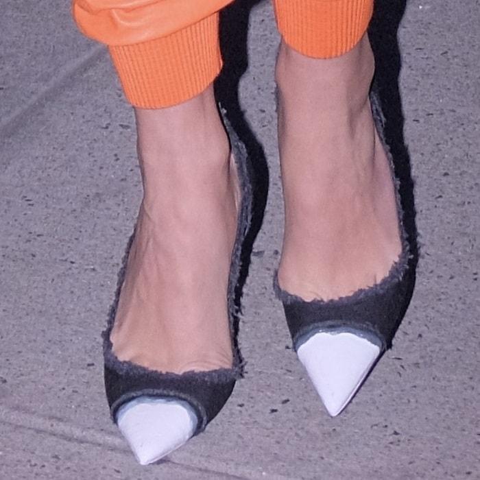 Rita Ora wearing frayed denim pumps from Tom Ford