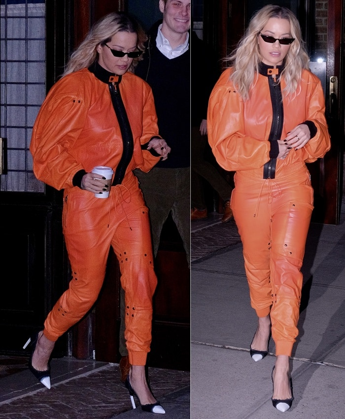 Rita Ora leaving her hotel in a crazy orange outfit from Tom Ford's Spring 2018 collection in New York City on February 1, 2018