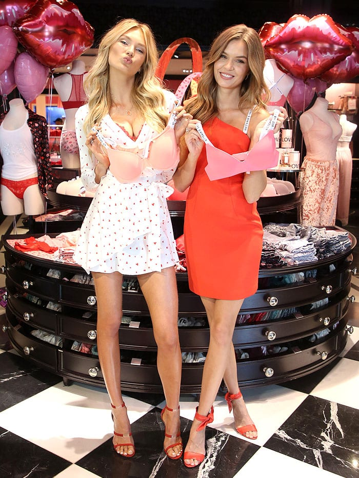 Victoria's Secret AngelsRomee Strijd and Josephine Skriver holding up bras from the new Dream Angels and Very Sexy collections.