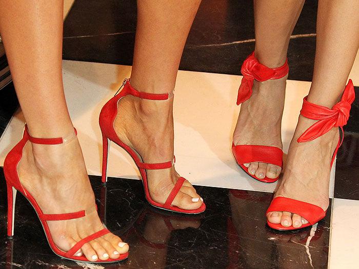 "Romee Strijd's feet in Tamara Mellon ""Reverse Frontline"" sandals and Joseph Skriver's feet in Stella Luna ""Carioca"" sandals"