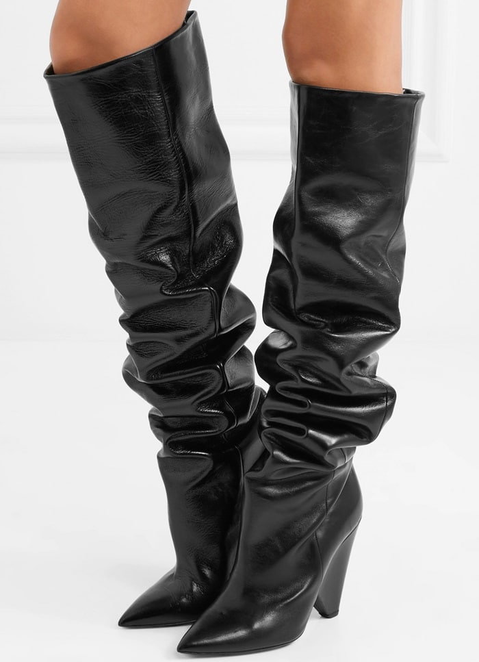 These 'Niki' boots are made from glossed-leather, set on the brand's signature cone heel and pointed at the toe