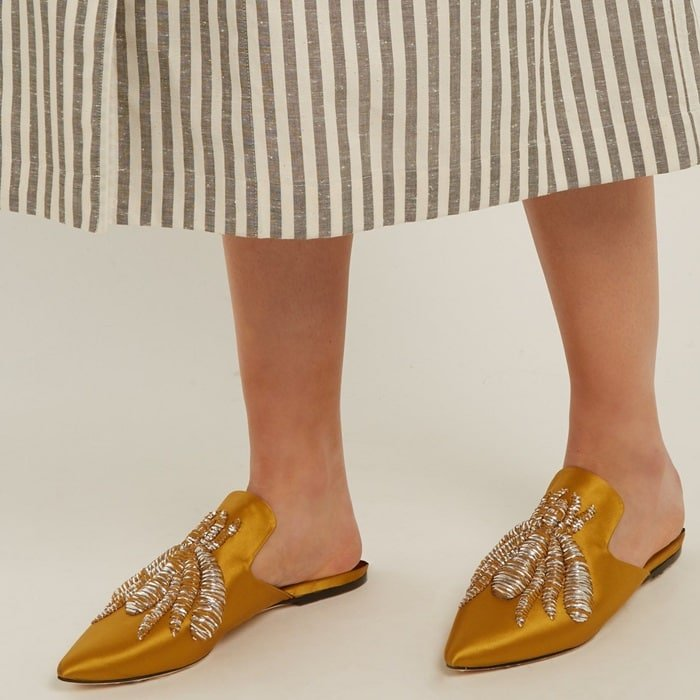 Made from mustard satin, they are embroidered with the label's signature spider in metallic threads that are outlined by wispy chiffon fringing