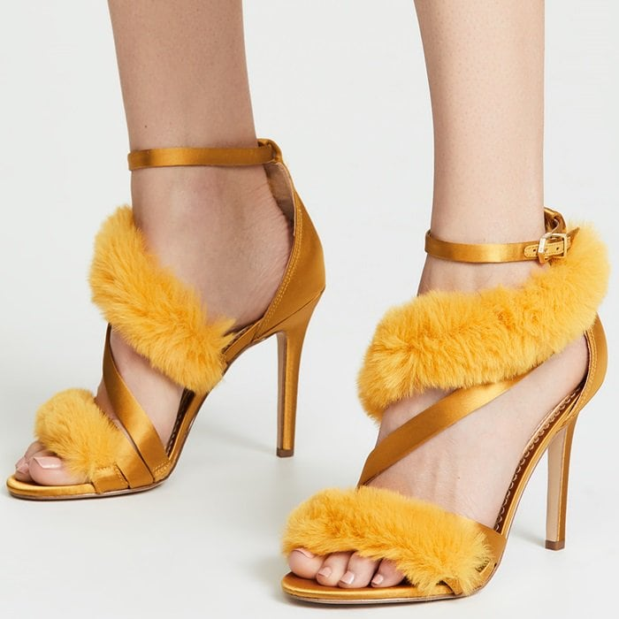 This stiletto, ankle wrap heel, which is made of satin and finished with a plush faux-fur wrap, is a fabulous pick for a night on the town