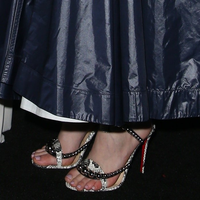 Saoirse Ronan showing off her feet in Christian Louboutin's 'Galeria' sandals that are crafted of black smooth leather and ivory and grey snakeskin