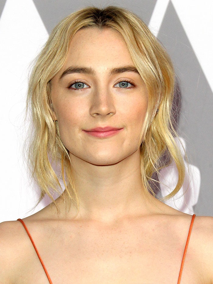 Saoirse Ronan wearing a deconstructed ponytail hairdo by Adir Abergel and Ana Khouri earrings.