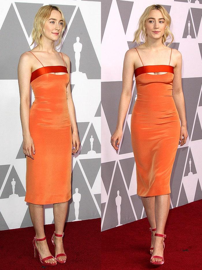 Saoirse Ronan's sexy legs in an orange-satin spaghetti-strap dress