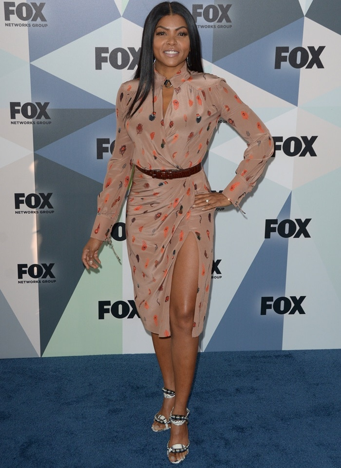 Taraji P. Henson in a feather-printed Altuzarra Fall 2018 dress featuring a collared neckline and wrap front bodice