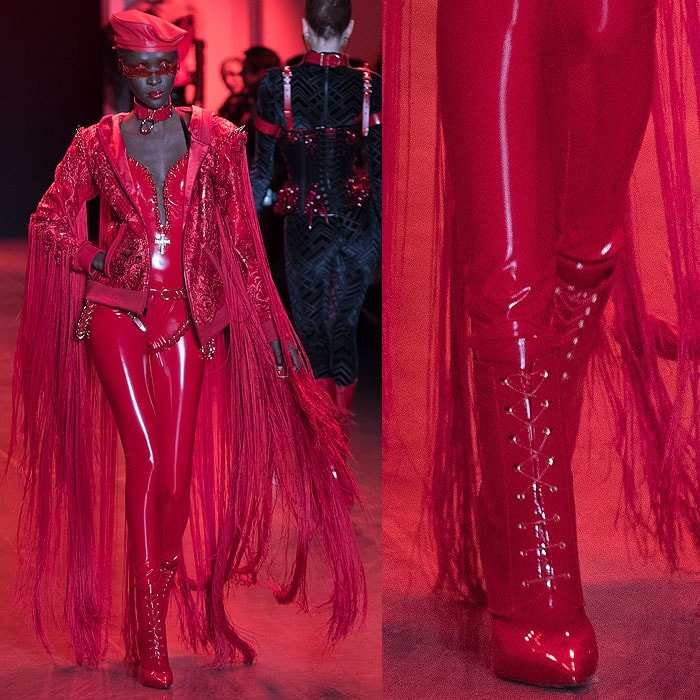 A model wearing a red latex jumpsuit with a long-fringed jacket and Christian Louboutin for The Blonds red patent lace-up booties.