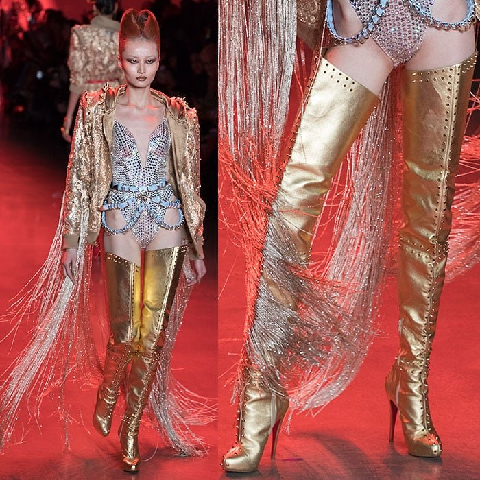 A model wearing a crystal-encrusted bodysuit with Christian Louboutin for The Blonds spike-studded gold thigh-high boots.