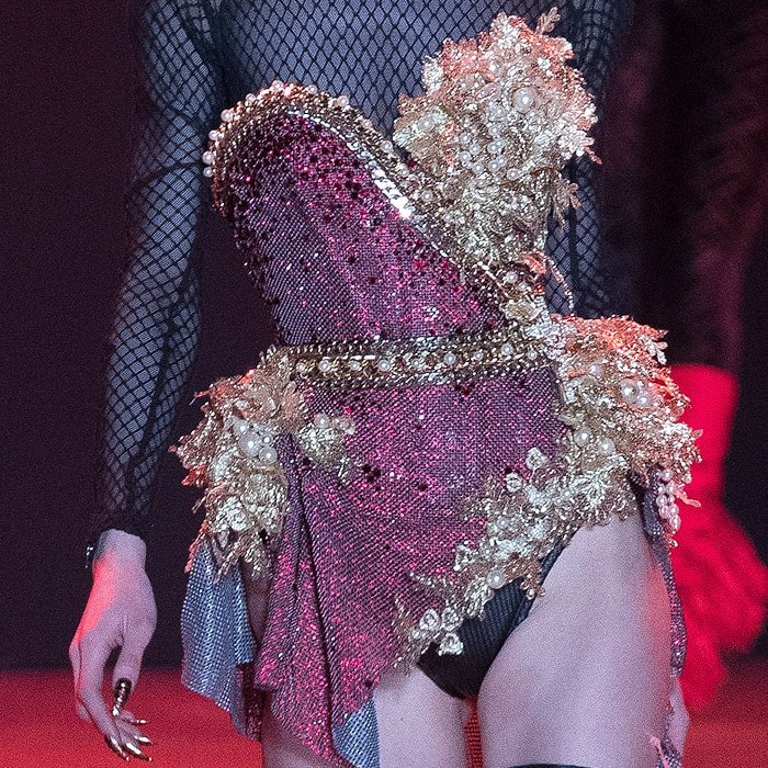 Draped-side chainmail corset with gold leaf and pearl embellishments.