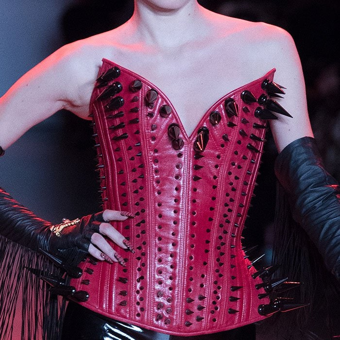 Red leather corset covered in black spikes