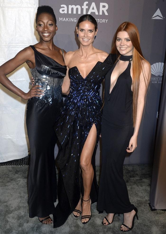 Models Toni Loba, Heidi Klum, and Barbara Meier attend the 2018 amfAR Gala New York at Cipriani Wall Street on February 7, 2018 in New York City