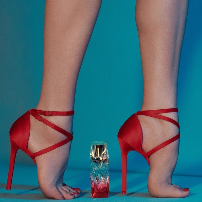 Model torturing her feet in half a pair of sandals to promote Christian Louboutin's 'Tornade Blonde' fragrance