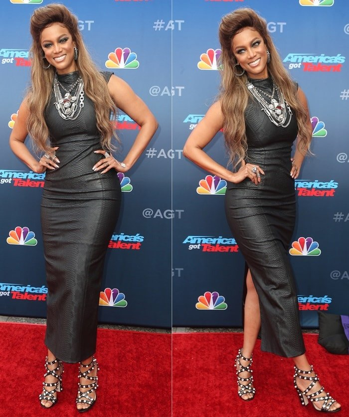 Tyra Banks wearing a faux leather cap sleeve ankle-length dress