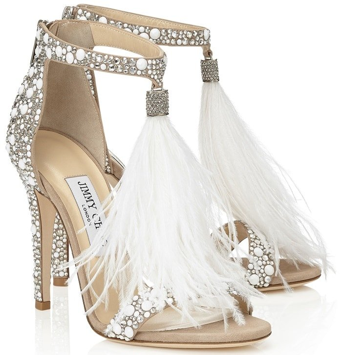 The upper is white suede with hotfix crystal embellishment, then finished with a white ostrich feathers tassel