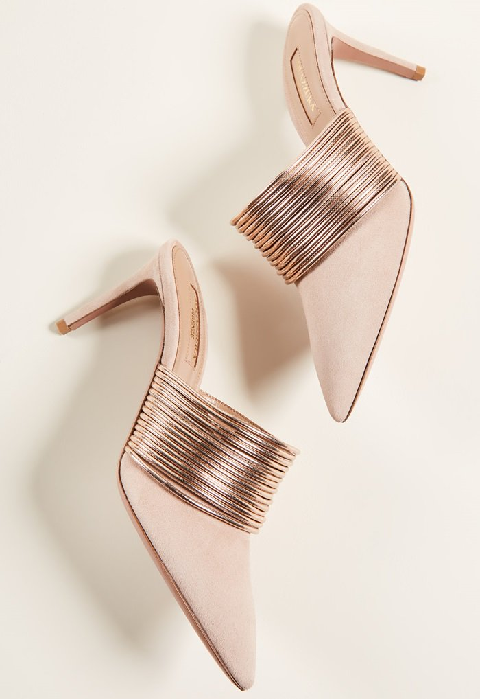 You definitely need a rendezvous with these amazing goatskin mules. Rose-gold cords amp up the glamour