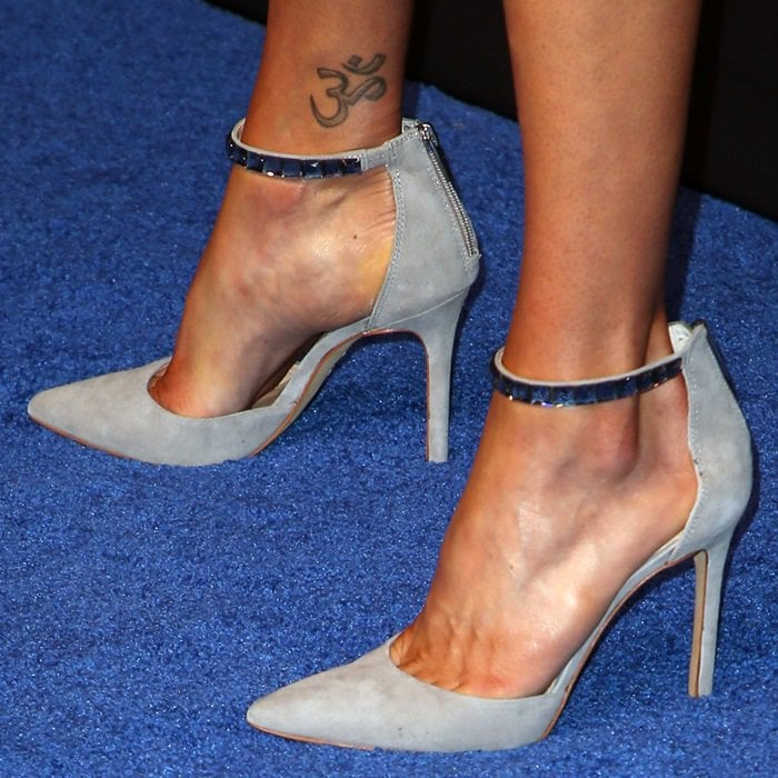 "Adrianne Palicki's ""Om"" symbol tattoo on her right ankle"