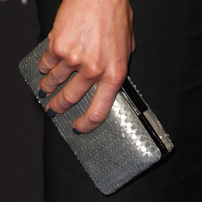 Adrianne Palicki showing off her manicure and metallic clutch
