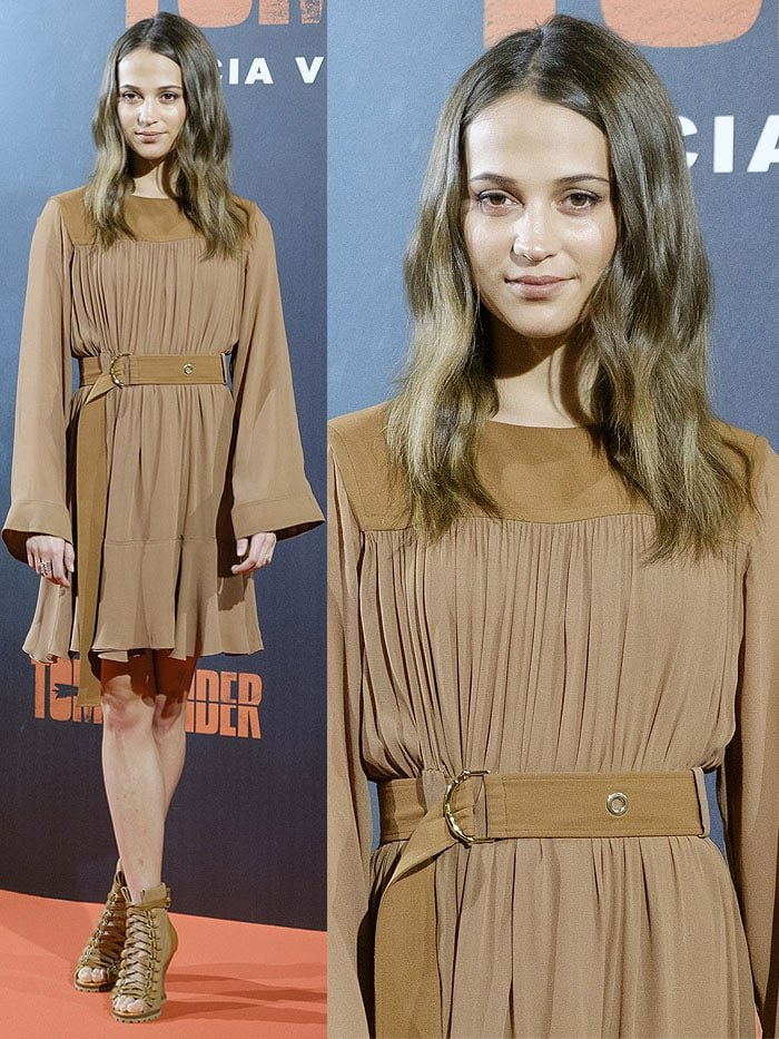 Alicia Vikander in a Chloe Pre-Fall 2018 brown belted dress and Chloe 'River' lace-up boots.