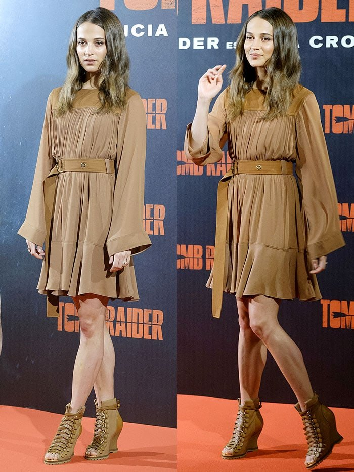 Alicia Vikander in a Chloe Pre-Fall 2018 brown belted dress and Chloe 'River'wedge booties.
