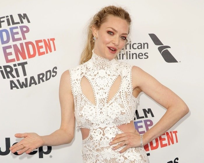 Amanda Seyfried in a white sleeveless lace embroidered dress from Alexander McQueen
