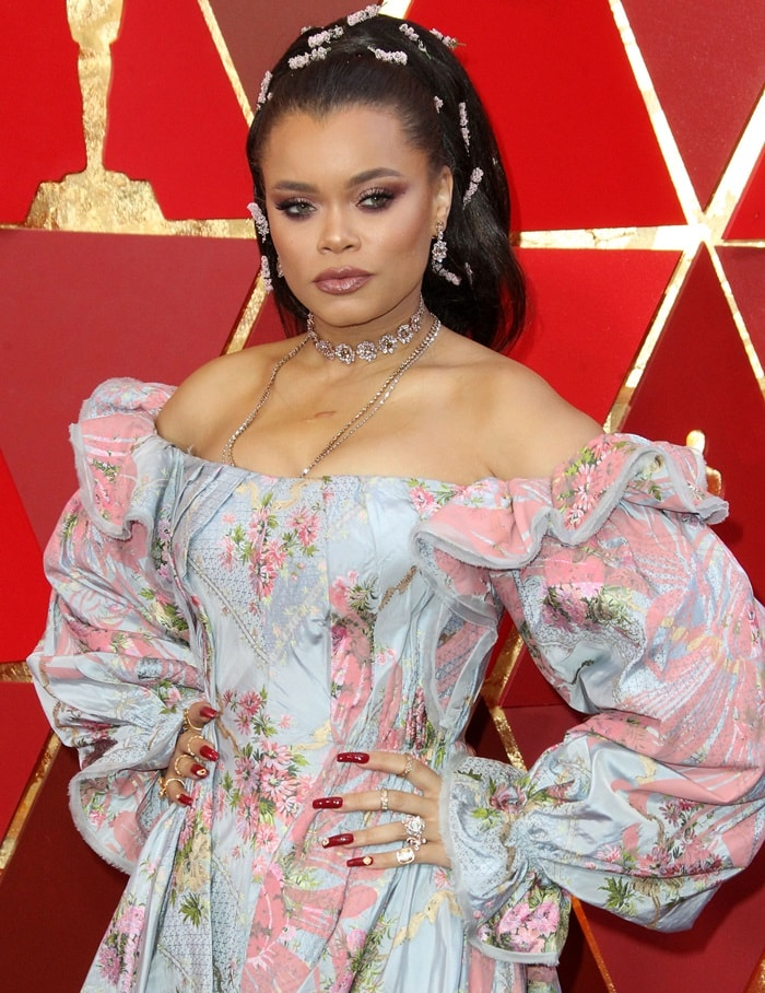 Andra Day wearinga floral pink and blue Zac Posen gown