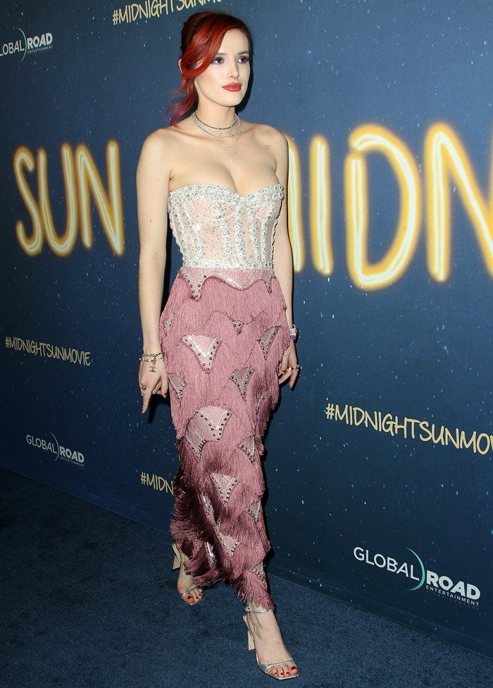 Bella Thorne's dress features a beaded silver bodice and a fringed purple skirt