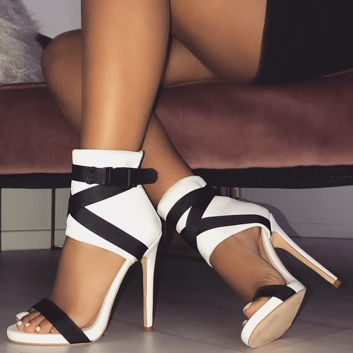 Featuring back zip, buckle strap detailing and a stiletto heel