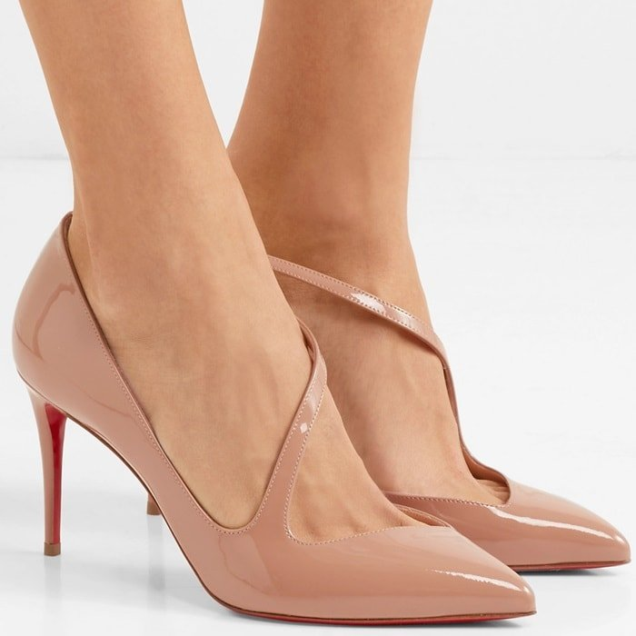 Expertly made in Italy from beige patent-leather, this point-toe pair has an asymmetric toe cap and is set on a slim 85mm heel