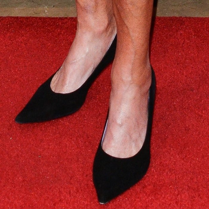Caitlyn Jenner's feet in black pointy-toe pumps