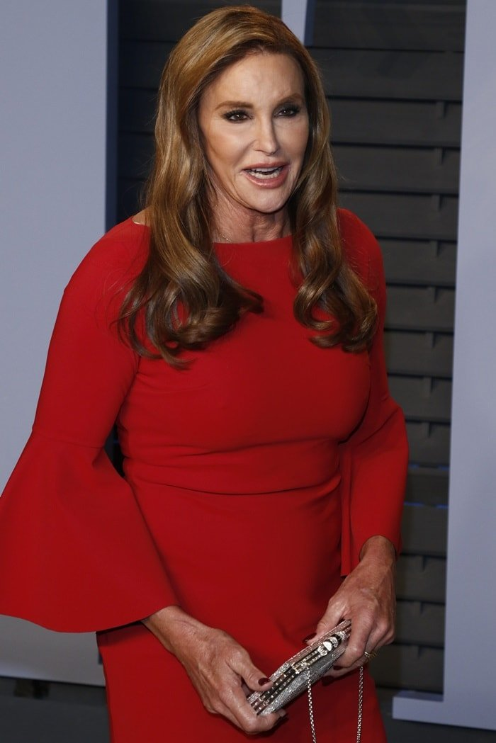 Caitlyn Jenner toting a personalized silver clutch that read 'Caitlyn'