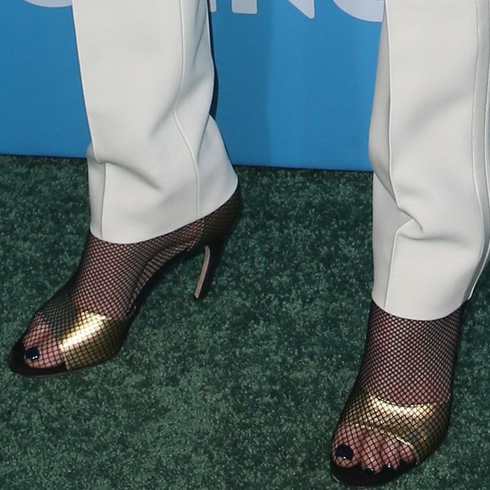 Charlize Theron's beautiful feet inDior fishnet overlay sandals