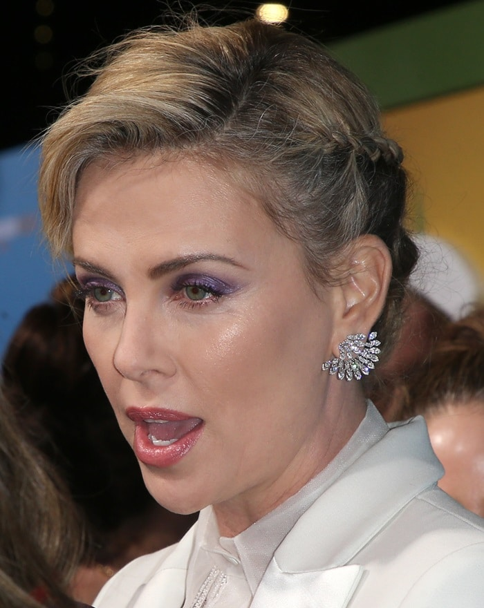 Charlize Theron's green eyes were made up with black mascara on the lashes