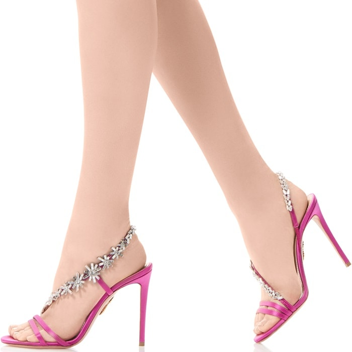The shimmering string of crystal flowers delicately grace the foot from the toes to around the ankle