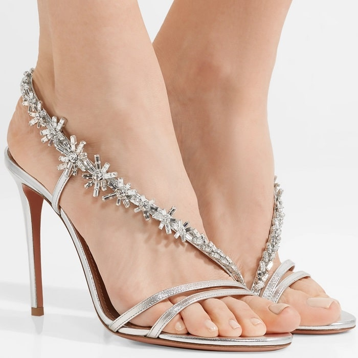 This silver leather pair is defined by its thin, crystal-embellished strap that elegantly wraps around your foot from heel to toe