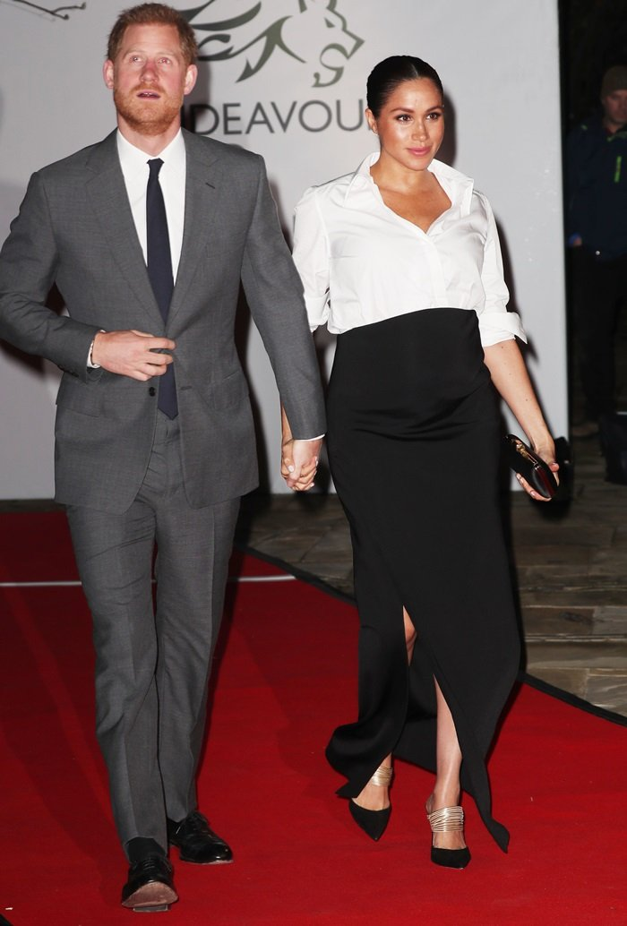 The Duke and Duchess of Sussex hold hands while arriving for the 2019 Endeavour Fund Awards held at Drapers' Hall in London, England on February 7, 2019
