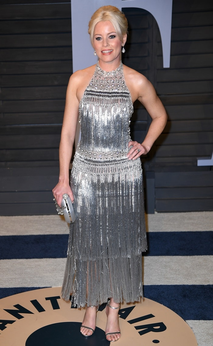 Elizabeth Banks in a glittering halter top and fringed skirtat the 2018 Vanity Fair Oscar Party