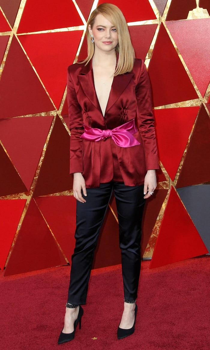Emma Stone in a horrid Louis Vuitton pantsuit