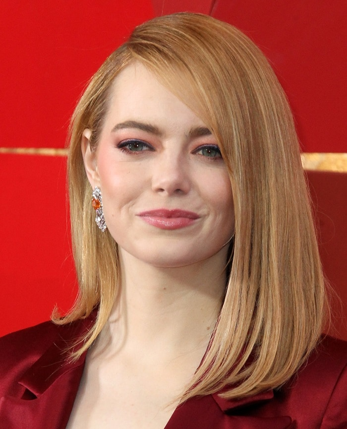 Emma Stone wearing sparkly drop earrings